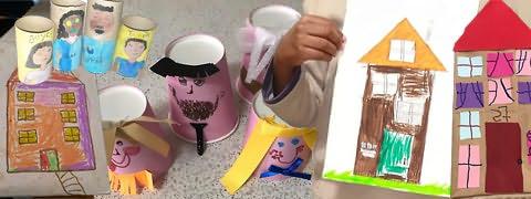 (Montagem fotográfica) Prédios desenhados, rolos de papel higiénico com figuras pintadas e alguns com papéis e fitas coladas a fazer de cabelo e mão segurando folha com prédio pintado